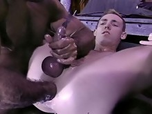 Cute stud shoots his load with a arm still lodged in his ass