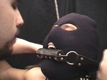 Tied slave has his dick beaten by Master