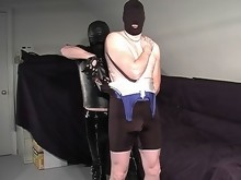 Masked slave in bear master's control