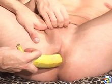 Sexy stud taking a banana and a dildo up his butthole