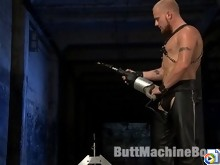 Luke Riley in full leather gets fucked by the Chopper, a motorcycle fucking machine.