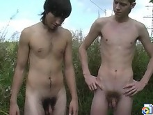 Skinny twinks get ass-spanked outdoors