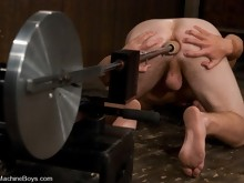 Hot stud is made to strip naked and then the machines fuck him to orgasm.