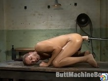 Stud gets fucked with the fucking machine while being sprayed with water.