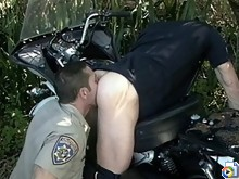 Officer buries his cock in a cop's ass